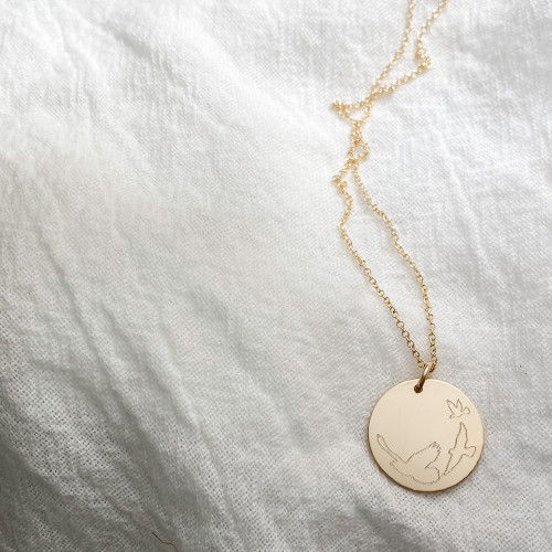 "Three Little Birds Engraved necklace. Shown in 3/4"" gold fill on cable chain."