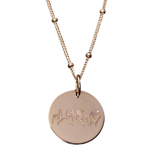 "Rose gold fill. ""love"" spelled out in ASL letters. Charm on satellite chain."