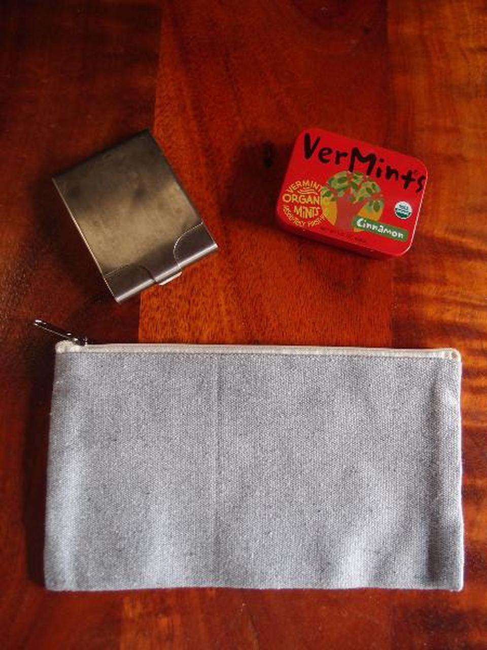 Gray Recycled Canvas Flat Zipper Pouch 9 inches, B694-70. This zipper bag functions perfectly as a makeup pouch, toiletry bag, pencil pouch, gadget pouch or cable pouch. It is perfect for carrying travel essentials.