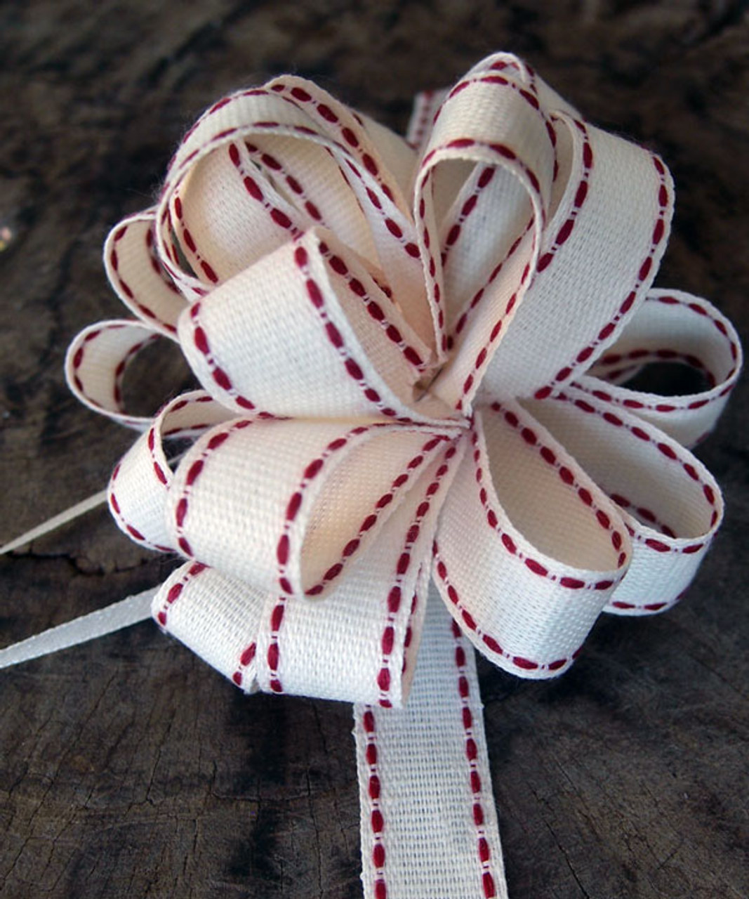 Wholesale cotton pull bows from Packaging Decor! These Canvas Pull Bow with Red Stitching pull bows are perfect for decorating and packaging of bouquets, floral arrangements, jewelry boxes, and gift baskets.