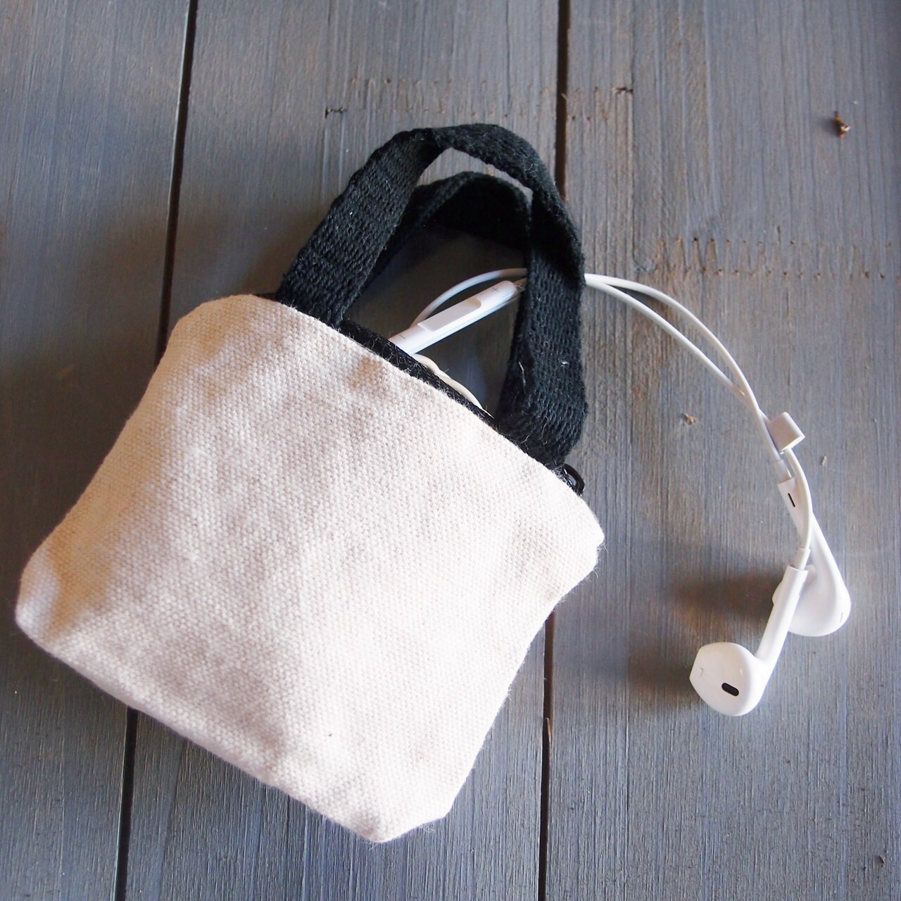 Natural Tiny Tote Zippered with Black Handles, B690-79. Buy wholesale mini tote bags and canvas shopping tote bags from Packaging Decor. Call (949) 833-7738.