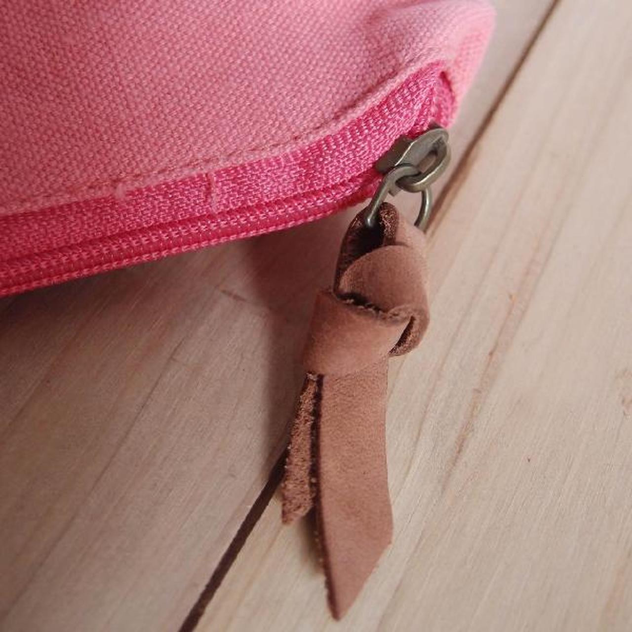"""Close up of the leather puller. Washed Canvas Zipper Pouch with Leather Puller Natural 8"""" x 6.3"""" x 2.4"""",  B686-75"""