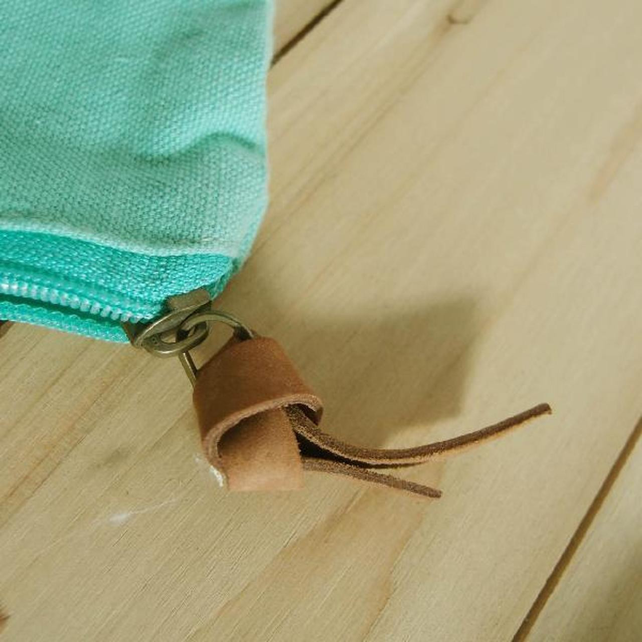 """Close up of the leather puller. Washed Canvas Zipper Pouch with Leather Puller Mint Green 8"""" x 6.3"""" x 2.4"""",  B686-77"""