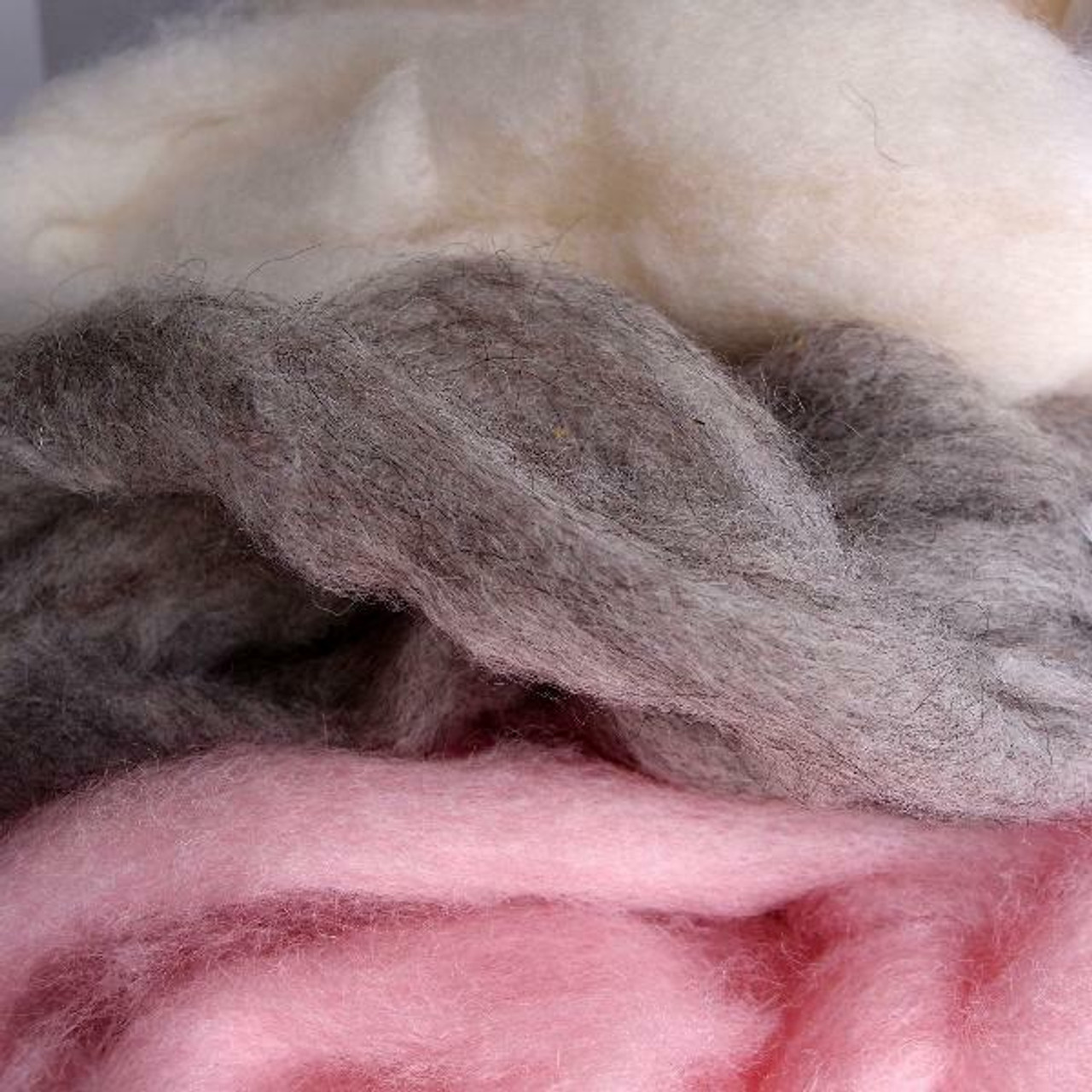 Wholesale White Wool Roving Fiber. What is Wool Roving Fiber? Wool roving refers to wool fiber that has been processed but not yet spun into yarn. They are mainly prepared for spinning to create yarn but they may also be used for specialized forms of felting, knitting or other textile arts.