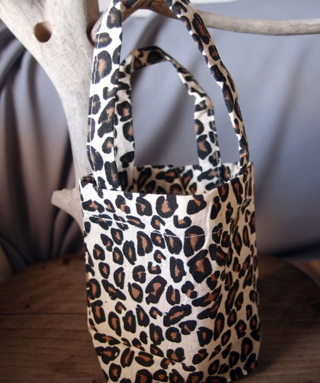 Wholesale Cotton Leopard Print Bags, 5 x 5 x 2 inches. Shop for wholesale cotton tote bags at Packaging Decor! Call (949) 833-7738.