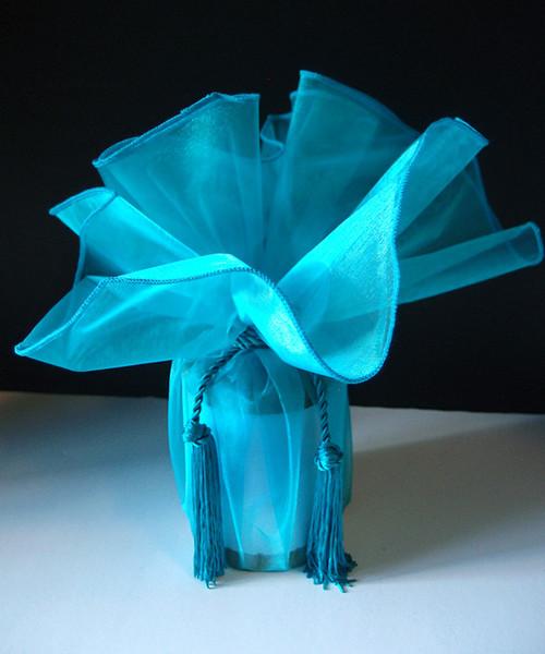 "Turquoise Wrapper w/Tassel 28"" dia."