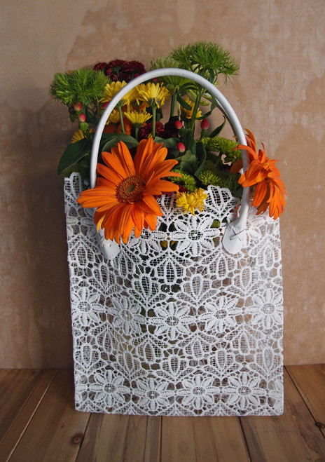 "This stylish lace bag measures 10 1/2""W x 4""D x 11""H. Stands 17"" tall including the vinyl covered handles. Made with stiffened lace."