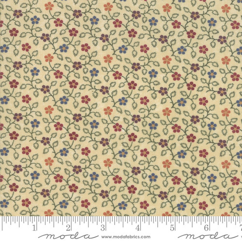 Small Multi Color Flowers on Tan Fabric
