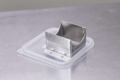 Aluminum shoot fits tightly to a CamSquare 6qt container and the shredder attachment.