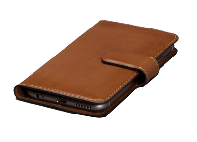 http://d3d71ba2asa5oz.cloudfront.net/12015324/images/iphone_6_burnished_magia_wallet_tan_desk_5.jpg