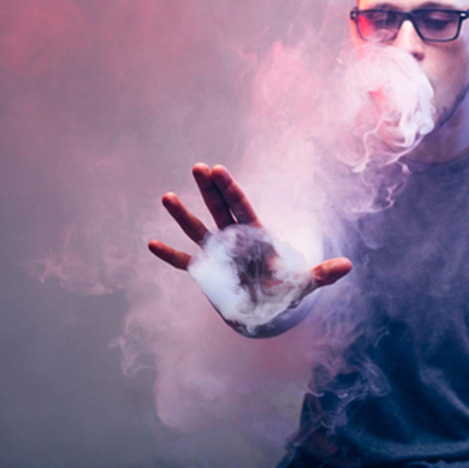 man performing vaping tricks
