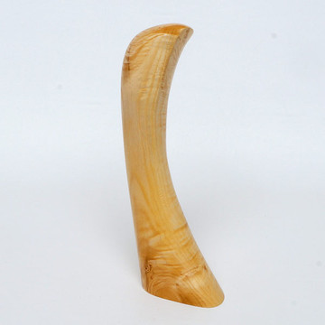 Horn-shaped maple sculpture with natural grain