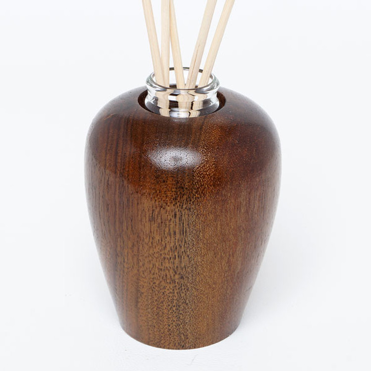 Handmade wood diffuser for essential oil aromatherapy includes glass vial and cork