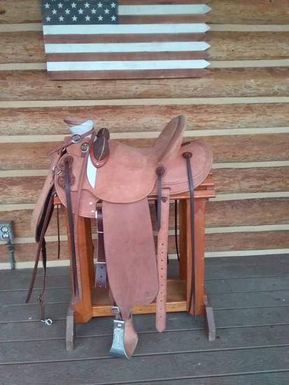 Full covered Wade. Base price $5000. Includes rough out or top grain. Rear tugs and back cinch. Rawhide or monel stirrups. Straight up pencil roll or Cheyenne roll.