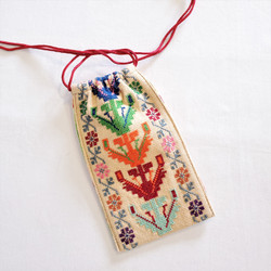 Fair trade cross stitch embroidered eye glasses case made by Syrian women