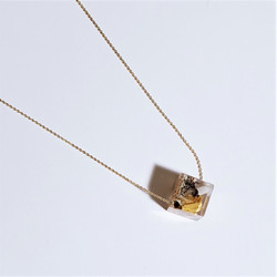 fair trade palo santo wood and eco resin on gold plated necklace from Colombia