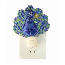 Fair trade beaded peacock night light from Haiti