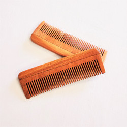 fair trade carved neem wood comb from India