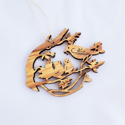 Fair trade olive wood cutwork song bird ornament from the Holyland