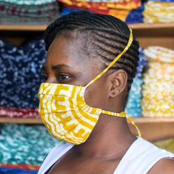 fair trade reusable cotton pleated face mask that ties behind head from Ghana