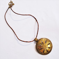 Fair trade embossed brass disc necklace from Egypt
