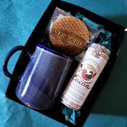 Fair trade drinking chocolate with ceramic mug and stroopwafel