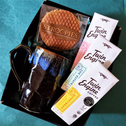 Fair trade organic whole bean coffee with ceramic mug from Japan and stroopwafel