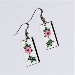 Fair trade primrose on eucalyptus wood dangle earring from Guatemala
