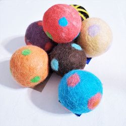 Fair trade felted wool dryer ball or pet toy from Mongolia