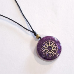 Fair trade resin mandala pendant from Chile