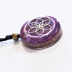Fair trade resin lotus pendant from Chile