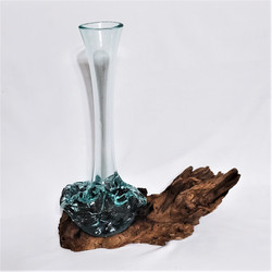Fair trade decorative glass vase on a tree root from Bali