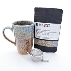 Filthy Mofo fair trade organic loose leaf tea with ceramic mug from Japan and tea steeper