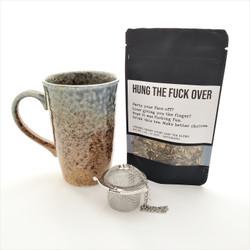 Hung the Fuck Over fair trade organic loose leaf tea with ceramic mug from Japan and tea steeper