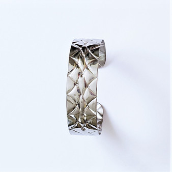 Fair trade stainless steel embossed bracelet from Dominican Republic
