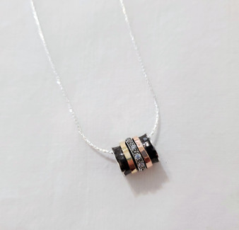 Fair Trade Sterling, Gold, and Cubic Zirconia Swivel Cylinder Necklace from Israel