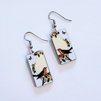 Fair trade swallow on eucalyptus wood dangle earring from Guatemala