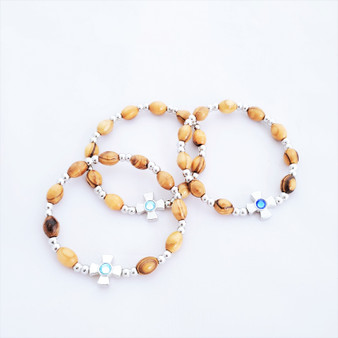 fair trade olive wood bracelet with cross bead from the Holyland