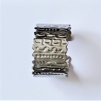 fair trade embossed stainless steel bracelet from Dominican Republic