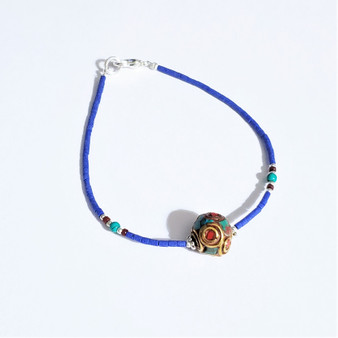 Fair trade single strand bracelet with inlaid brass bead from Nepal