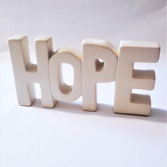 fair trade carved soapstone hope shelfsitter from Kenya