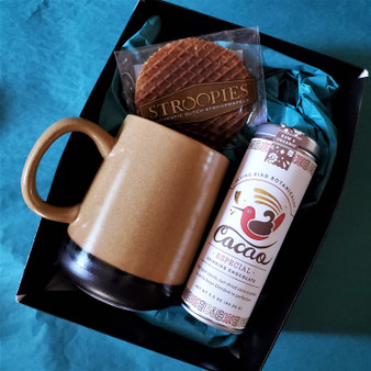 Fair trade drinking chocolate with ceramic mug and stroopwafel