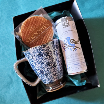 Fair trade organic herbal tea with ceramic mug from Japan and stroopwafel