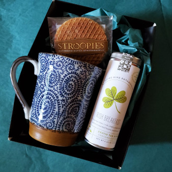 Fair trade organic black tea with ceramic mug from Japan and stroopwafel