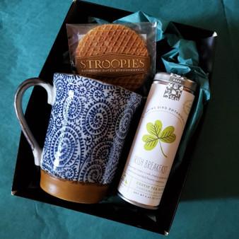 Fair trade organic black tea with ceramic mug from Japan and stroopwafel