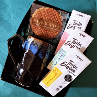 Fair trade organic ground coffee with ceramic mug from Japan and stroopwafel