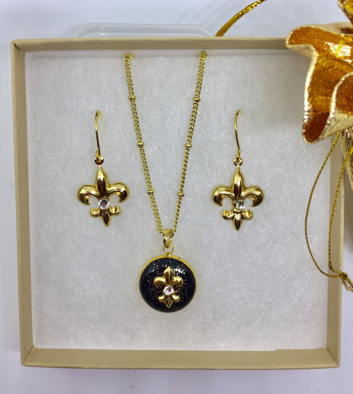 You'll enjoy wearing this combination embellished with gold gilt charms and Swarovski clear cystals.