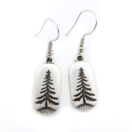 Pair of silver earrings with a bold pine tree design