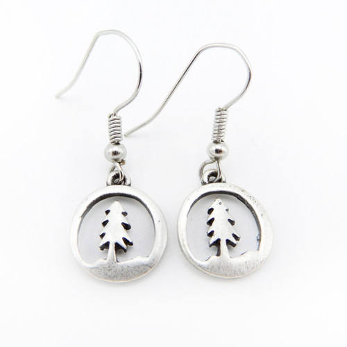 Pair of small round earrings with pine tree silhouettes