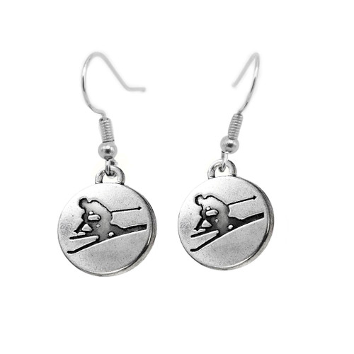 Embossed alpine skier on a sterling silver disc
